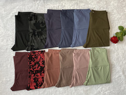 Pantaloni da donna a colori solidi Pantaloni a vita alta Gym Sports Gym Indossare Leggings Elastico Fitness Lady Complessivamente collant in Offerta