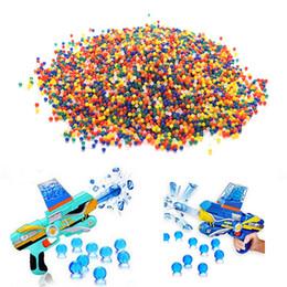Elektrikli Su Bullet Paintball 7mm Renk Kristal Yumuşak Silah Oyuncak Çamur Boncuk Topları Büyümek Topları Toprak Guns Aksesuarları Erkek Oyuncaklar 20000 adet 1 Şişe