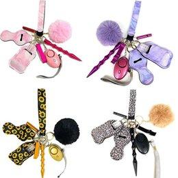Wholesale 15 Colors 9 pcs Defense Keychain Set Alarm Pompom Hand Sanitizer Wrist strap Lipstick Keychains Stick Bottle Opener For Woman Men Self-defense Keyring