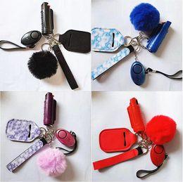 Fashion 1 Set=5 pcs Defense Keychains Set Lncluding 20ml Spray Alarm Pompom Keychain Hand Sanitizer Wristband Keyrings For Woman Men Self-defense Keyring on Sale