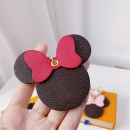 Discount mickey light Luxury Brown Spots Square Pattern Leather Keychain Old Flower Mickey Minnie Circle Buckle Car Keyring Accessories High Quality