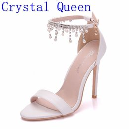 Discount white pearl ankle strap shoes Crystal Queen Women Elegant Heels Wedding Shoes For Women High Heel Sandals Pearls Tassel Chain Platform White Party Shoes Y0305