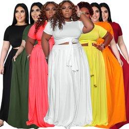Talla grande Ropa de mujer Vestido de moda Moda grande Color sólido Cross Vendaje Falda de swing Falda de dos piezas en venta