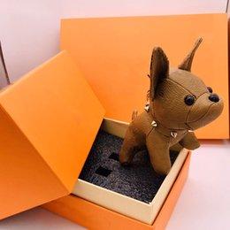 Venta al por mayor de Moda llaveros diseñador llave hebillas bolso colgante bolsas perros diseño lujo muñeca cadenas llaves llaves hebilla 7 colores de alta calidad con caja opcional