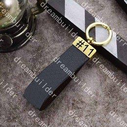 Wholesale M65221 Luxury fashion Designer straps Handmade PU Leather Car Keychain Women Bag Charm Pendant Accessories