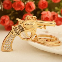 smallest gun NZ - Hot Small Gold Plated Pistol Gun Key Chain Ring Fashion Rhinestone Trinkets Metal Keychain for Women Bag Charm Pendant Jewelry