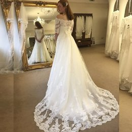 wedding dress short removable train NZ - A-line Wedding Gowns Illusion Off the Shoulder Lace Tulle Wedding Dress with Short Sleeves Appliques Custom Made Bridal Gown Removable Train