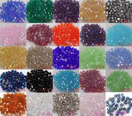 Vente en gros 4mm Bicone Perles d'entretoise en cristal lâche 1000pcs / lot pour bijoux Fournitures Fournitures Collier Bracelet Collier DIY Accessoires U Chemin en Solde