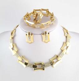 Venta al por mayor de Dubai africano 18 k chapado en oro misterioso collar con encanto pendiente de la manera romántica ganó bodas de las mujeres joyería nupcial trajes