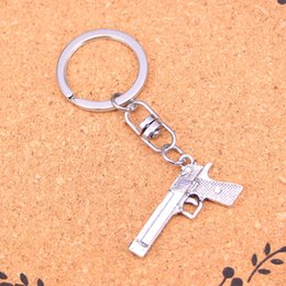 $enCountryForm.capitalKeyWord UK - New Arrival Novelty Souvenir Metal gun browning pistol Key Chains Creative Gifts Apple Keychain Key Ring Trinket Car Key Ring