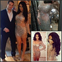 Robe De Bal Tulle Nue Pas Cher-2018 Kim Kardashian Robes Nude Cristaux Robe de cocktail avec manches longues Sheer Neck Bling Champagne Rhinestones Sheath Prom Evening Gowns