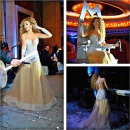 See Through Prom Dresses Rhinestones NZ - 2015 Meryam Fares Celebrity Dress Champagne Mermaid Prom Dresses Long Sleeves Rhinestone Crystals See Through Evening Gowns