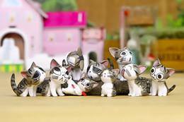 La mano della bambola del gatto del formaggio del giocattolo degli ornamenti del paesaggio del muschio micro fa la bambola della decorazione della bottiglia di ecologia