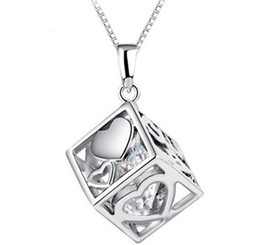 Ensemble D'habillement D'amour Pas Cher-Top Women Bijoux AAA diamant Autriche Magic Love Cube cristal de zircon cubique 925 collier pendentif en argent sterling pour robe de mariée Sets Party