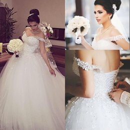Chinese  Gorgeous Crystals Sparkly White Ball Gown Wedding Dresses Formal Off the Shoulder Sequins Beading Lace-up Back Church Bridal Gowns Puffy manufacturers