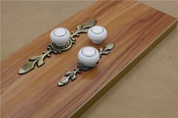 red kitchen cabinet handles NZ - 2016 new marble white ceramic single door knob pull with Red bronze and bronze base cabinet kitchen drawer pull furniture handles #244