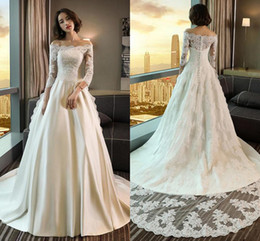 Elegantes Blusas De Manga Larga Baratas Baratos-Off Shoulder mangas largas vestidos de novia 2018 Top apliques de encaje A Line Court Train Elegantes vestidos de novia Vestidos De Noiva Cheap Customized