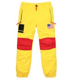 Flags yellow online shopping - 17ss BOX LOGO Flag Punch Pants Men Women Trousers Fashion Gore Tex Pant Top Quality S XL HFKZ002