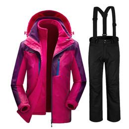 Venta al por mayor de Rusia invierno -35 grados trajes de esquí trajes de snowboard femeninos impermeable súper cálida chaqueta de esquí + pantalones para las mujeres deporte al aire libre abrigo pantalón