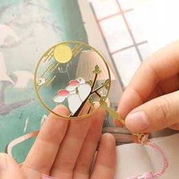 Kinesisk stil souvenirer Utsökt ihålig metallbokmärken med tofsar Små gåvor Konsttillbehör Kulturell kreativ present