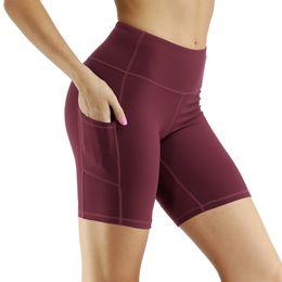 Mulheres fitness ginásio shorts ciclismo meia-calça magro atlético vestuário treino corger capris Quickdry yoga treinamento jersey com bolso em Promoção