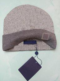 Groothandel muts winter caps hoeden vrouwen en mannen mutsen met echte wasbeer bont pompoms warme meisje cap snapback pompon
