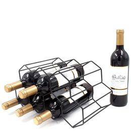 venda por atacado Cremalheiras de vinho de mesa de alta qualidade decoração de rack dourado nórdico ferro forjado criativo para salas de estar escritórios Garrafa suporte