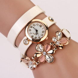 $enCountryForm.capitalKeyWord NZ - Wholesale-2014 New women vintage leather strap watches,set auger flower rivet bracelet women dress watch,women wristwatches XR292