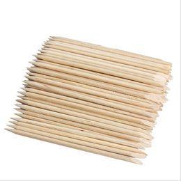 Venta al por mayor de Al por mayor-100pcs Nail Art Orange Wood Stick Cuticle Pusher Remover para manicura Cuidado Nail Art Tool Envío gratis