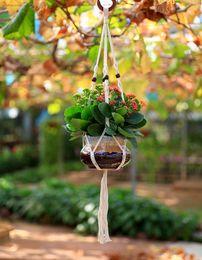 FDS Flower Pot Basket Corda appesa a mano in rete di cotone coperta interna appeso pianta perline in legno decorativo 4 gambe giardino prodotto in Offerta