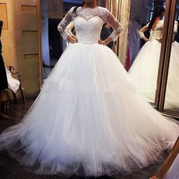 2015 Modest Ball Gown Wedding Dresses Sheer Long Sleeves Royal Princess Lace Appliques Fluffy Tulle Plus Size Arabic Bridal Gowns With Belt
