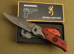 Venta al por mayor de ¡Alta calidad! Cuchillo plegable DA30 Browning Superficie de titanio Incrustaciones de madera dura Mango Caza Camping 330 Cuchillo de combate