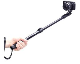 China C188 Retractable Handheld Monopod with phone Clips holder for Pocket Camera and iPhone Samsung HTC...etc Mobile Phones cheap handheld for camera suppliers