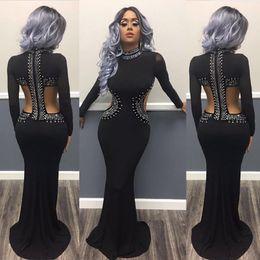 Las mujeres del otoño mangas largas vestidos de noche de la sirena recorte atractivo imprimieron la longitud del piso ajustado Formal Club Party Prom Vestidos en negro