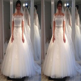 wedding dress pleated skirt flowers UK - 2018 Ball Gown Wedding Dresses Bateau short sleeve Illusion Full Lace Appliques Tulle Tiered Skirts Court Train with Beading Bridal Gowns