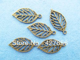 pendants out leaves Australia - 500pcs Antique Bronze small delicated cute hollow out leaves pendant hanging charm finding