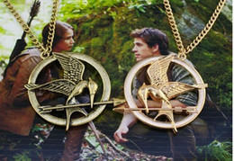 Mockingjay pendant necklace canada best selling mockingjay 2016 new in vintage style hunger games mockingjay pendant necklace 3 colors 12pcs lot free shipping mozeypictures Images