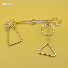 China Intelligence Lock Knot Brain Wire Puzzles Ring Game Develop Your Wisdom Cross Metal Magic Toys suppliers