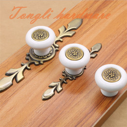 $enCountryForm.capitalKeyWord Canada - Flower carving elliptical zinc alloy white ceramic single door knob cabinet pull kitchen drawer handles accessories with bronze base #43