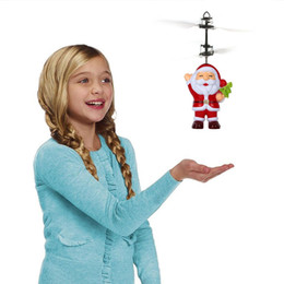 wholesale electric helicopters Canada - Santa Claus Electric Infrared Sensor Flying Ball Father Christmas Inductive Aircraft Helicopter Flying Toys Christmas Gift 10pcs OOA3488