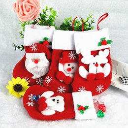 $enCountryForm.capitalKeyWord Australia - hot Thanksgivin 12pcs lot Christmas Decorations Gifts Santa Snowman Deer Stocking Xmas Home Decorations 9*16cm Hight Best Gifts for children