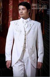 Black Suit Ivory Waistcoat Canada - 3 Buttons Embroidery Groom Tuxedos Peak Lapel Groomsman Suits (Jacket+Pants+Tie+Waistcoat) G687
