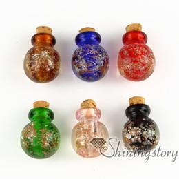 Venta al por mayor de pequeñas botellas de vidrio para collares colgantes joyas conmemorativas para las cenizas joyas de cenizas de perro