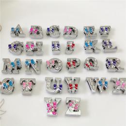 $enCountryForm.capitalKeyWord Canada - Wholesale 52PCS Lot 8MM Full Rhinestones Bowknot Slide Letters A-Z Alphabet DIY Slide Charms Fit 8MM Wristbands Bracelets Belts SL17