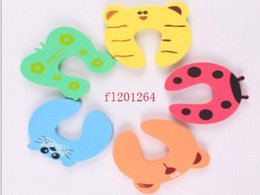 door baby holder Canada - Free Shipping Door Stopper Child Kids Baby Animal Cartoon Jammers Holder Lock Safety Guard Finger Protect ,500pcs lot