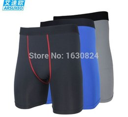 Sous-vêtement De Football En Gros Pas Cher-Gros-2015 nouvelle ARSUXEO mens collants de compression de base de sous-vêtements de la couche courante basket football de football de boîte de shorts.cycling shorts.DK-1