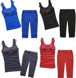 Black Yoga Sets Canada - Woman sports set spaghetti strap vest capris running fitness sports set yoga