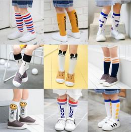 Knee Socks Toddler Girls Canada - Kids Boys Girls Cartoon Long Socks Cute Cotton Toddler Baby Leggings Children Stripe Smile Face Dot Knee Socks Stockings Leg Warmers