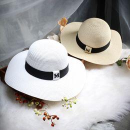 96ff4f2d Wholesale- Hot sale M letter Seaeside sun hats for women summer large  brimmed straw hat folding beach girls sun hat wholesale