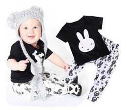 Tracksuit Rabbit NZ - baby boys suit kids brand tracksuits boys Cute rabbit short sleeved T-shirt+pants 2 sets free shipping hot sale new fashion spring autumn.